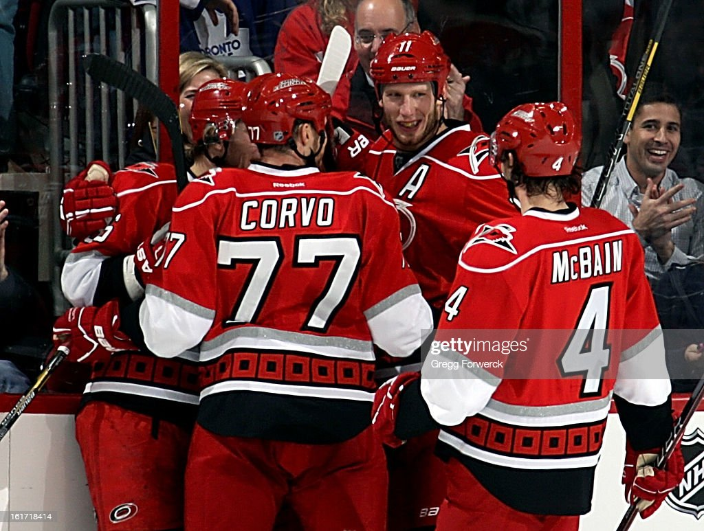 Jussi Jokinen #36 of the Carolina Hurricanes is surrounded by teammates Joe Corvo #77, Jordan Staal #11 and Jamie McBain #4, following his second-period goal against the Toronto Maple Leafs during their NHL game at PNC Arena on February 14, 2013 in Raleigh, North Carolina.