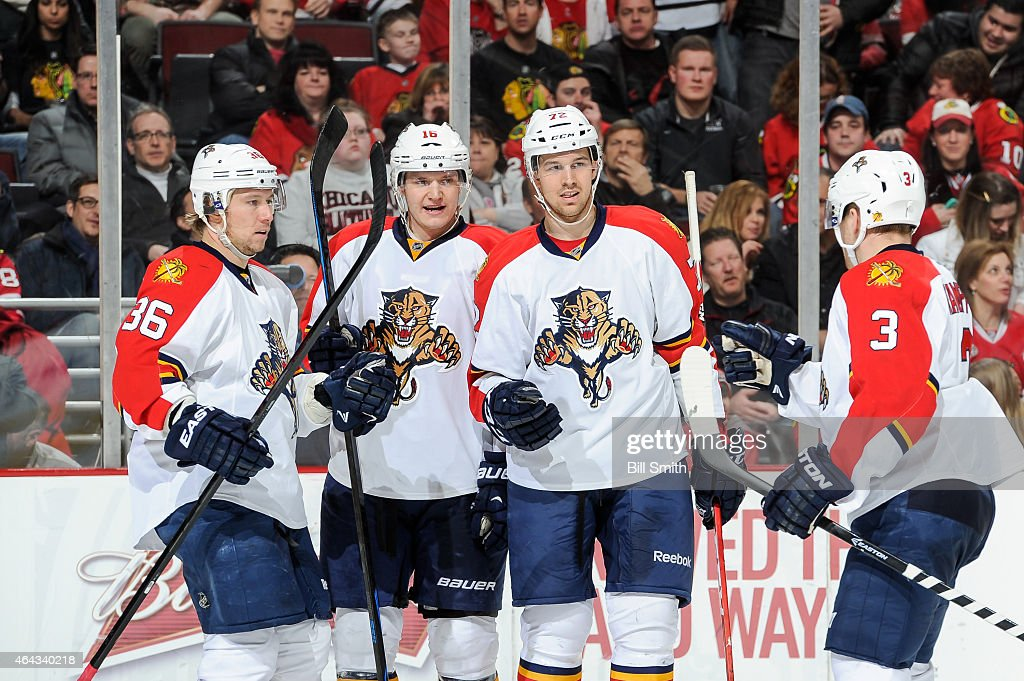 <a gi-track='captionPersonalityLinkClicked' href=/galleries/search?phrase=Jussi+Jokinen&family=editorial&specificpeople=570599 ng-click='$event.stopPropagation()'>Jussi Jokinen</a> #36 of the Florida Panthers (left) celebrates with teammates <a gi-track='captionPersonalityLinkClicked' href=/galleries/search?phrase=Aleksander+Barkov&family=editorial&specificpeople=8760147 ng-click='$event.stopPropagation()'>Aleksander Barkov</a> #16, <a gi-track='captionPersonalityLinkClicked' href=/galleries/search?phrase=Alex+Petrovic&family=editorial&specificpeople=8639704 ng-click='$event.stopPropagation()'>Alex Petrovic</a> #72 and <a gi-track='captionPersonalityLinkClicked' href=/galleries/search?phrase=Steven+Kampfer&family=editorial&specificpeople=7215176 ng-click='$event.stopPropagation()'>Steven Kampfer</a> #3 after scoring against the Chicago Blackhawks in the third period during the NHL game at the United Center on February 24, 2015 in Chicago, Illinois.