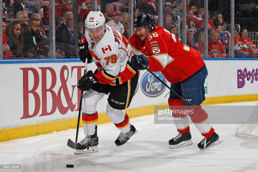 Jussi Jokinen #36 of the Florida Panthers checks Micheal Ferland #79 of the Calgary Flames as he circles the net with the puck during second period action at the BB&T Center on February 24, 2017 in Sunrise, Florida. The Flames defeated the Panthers 4-2.