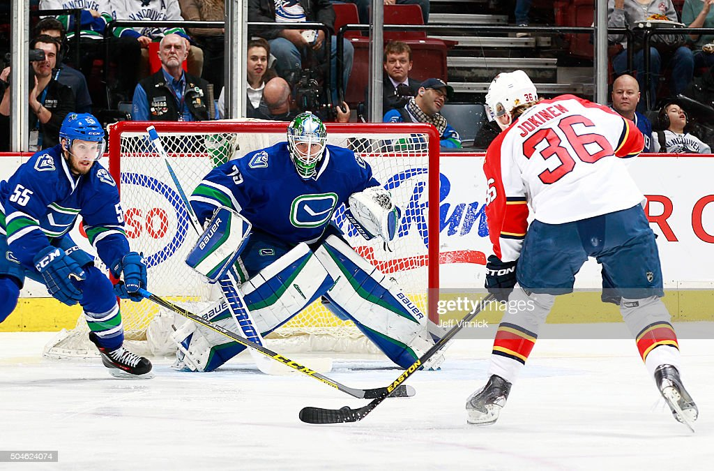 Jussi Jokinen #36 of the Florida Panthers fires a shot that beat Jacob Markstrom #25 of the Vancouver Canucks as Alex Biega #55 of the Canucks watches during their NHL game at Rogers Arena January 11, 2016 in Vancouver, British Columbia, Canada.