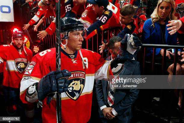 Jussi Jokinen of the Florida Panthers heads out to the ice prior to the start of the game against the Carolina Hurricanes at the BBT Center on March...
