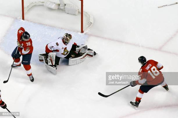Jussi Jokinen of the Florida Panthers looks back as goaltender Mike Condon of the Ottawa Senators stops a shot by Reilly Smith during second period...