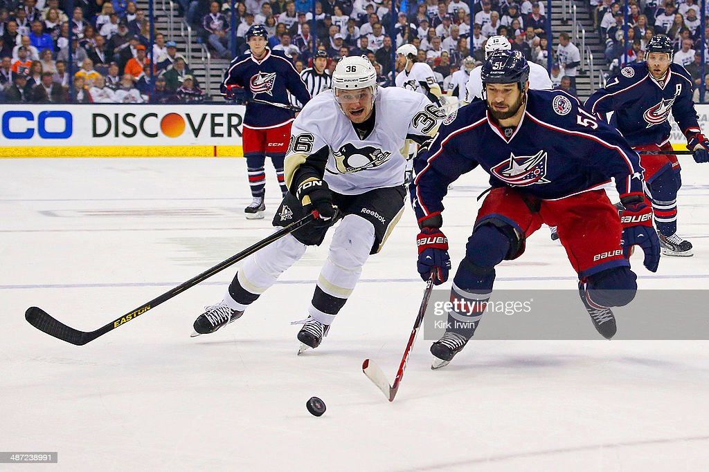 <a gi-track='captionPersonalityLinkClicked' href=/galleries/search?phrase=Jussi+Jokinen&family=editorial&specificpeople=570599 ng-click='$event.stopPropagation()'>Jussi Jokinen</a> #36 of the Pittsburgh Penguins and <a gi-track='captionPersonalityLinkClicked' href=/galleries/search?phrase=Fedor+Tyutin&family=editorial&specificpeople=215245 ng-click='$event.stopPropagation()'>Fedor Tyutin</a> #51 of the Columbus Blue Jackets chase after the puck during the first period of Game Six of the First Round of the 2014 NHL Stanley Cup Playoffs at Nationwide Arena on April 28, 2014 in Columbus, Ohio. Pittsburgh defeated Columbus 4-3 to win the series four games to two.