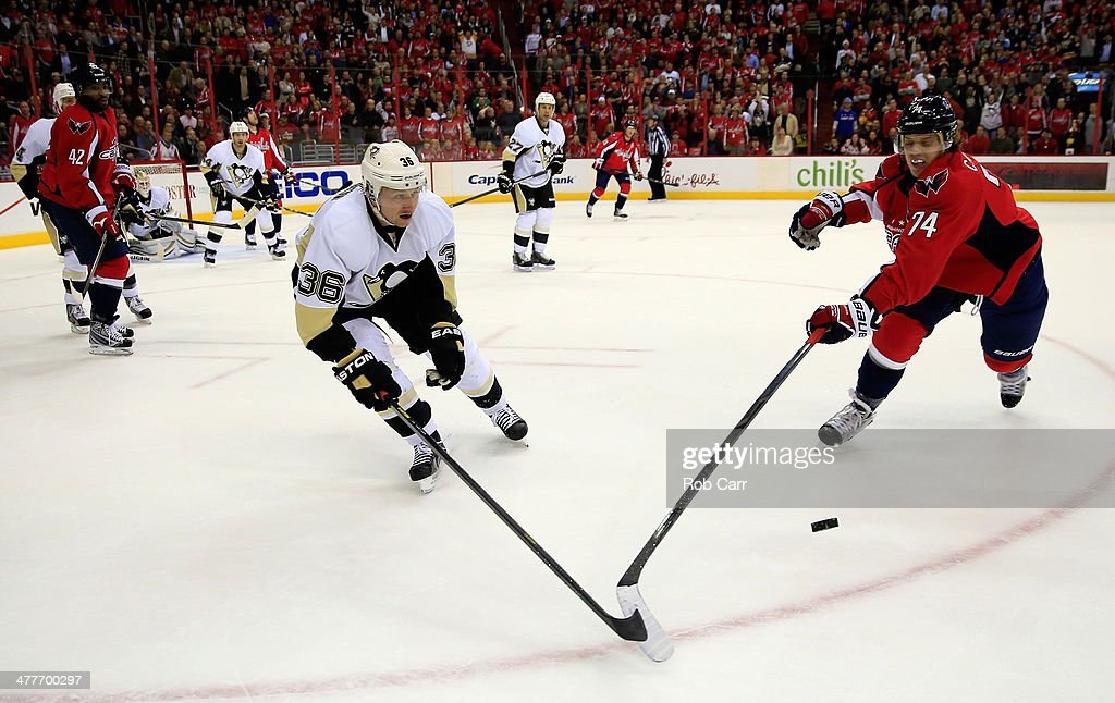 <a gi-track='captionPersonalityLinkClicked' href=/galleries/search?phrase=Jussi+Jokinen&family=editorial&specificpeople=570599 ng-click='$event.stopPropagation()'>Jussi Jokinen</a> #36 of the Pittsburgh Penguins and John Carlson #74 of the Washington Capitals go after the puck during the third period of the Penguins 3-2 win at Verizon Center on March 10, 2014 in Washington, DC.