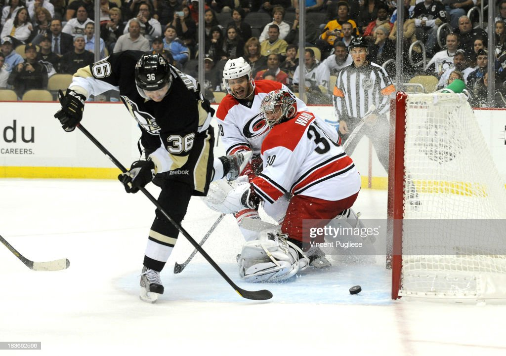 <a gi-track='captionPersonalityLinkClicked' href=/galleries/search?phrase=Jussi+Jokinen&family=editorial&specificpeople=570599 ng-click='$event.stopPropagation()'>Jussi Jokinen</a> #36 of the Pittsburgh Penguins beats <a gi-track='captionPersonalityLinkClicked' href=/galleries/search?phrase=Cam+Ward&family=editorial&specificpeople=453216 ng-click='$event.stopPropagation()'>Cam Ward</a> #30 of the Carolina Hurricanes to give the Penguins a 1-0 lead during the first period on October 8, 2013 at the CONSOL Energy Center in Pittsburgh, Pennsylvania.