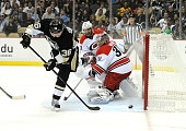 Jussi Jokinen of the Pittsburgh Penguins beats Cam Ward of the Carolina Hurricanes to give the Penguins a 10 lead during the first period on October...