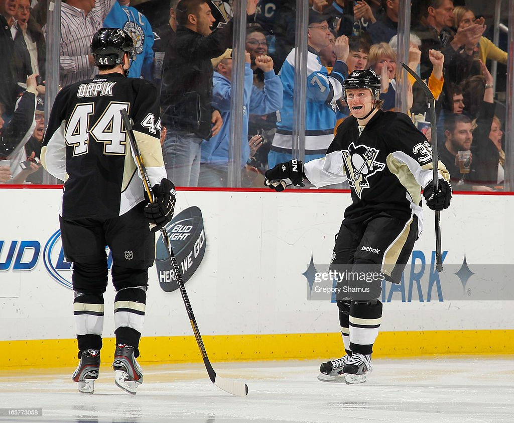 <a gi-track='captionPersonalityLinkClicked' href=/galleries/search?phrase=Jussi+Jokinen&family=editorial&specificpeople=570599 ng-click='$event.stopPropagation()'>Jussi Jokinen</a> #36 of the Pittsburgh Penguins celebrates his goal with <a gi-track='captionPersonalityLinkClicked' href=/galleries/search?phrase=Brooks+Orpik&family=editorial&specificpeople=213074 ng-click='$event.stopPropagation()'>Brooks Orpik</a> #44 during the third period against the New York Rangers on April 5, 2013 at Consol Energy Center in Pittsburgh, Pennsylvania. Pittsburgh won the game 2-1 in a shootout.