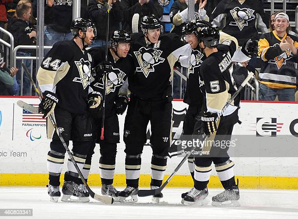 Jussi Jokinen of the Pittsburgh Penguins celebrates his goal with teammates during the second period against the Winnipeg Jets on January 5 2014 at...