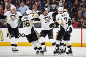 Jussi Jokinen of the Pittsburgh Penguins celebrates his third period gamewinning goal with his teammates in Game Three of the First Round of the 2014...