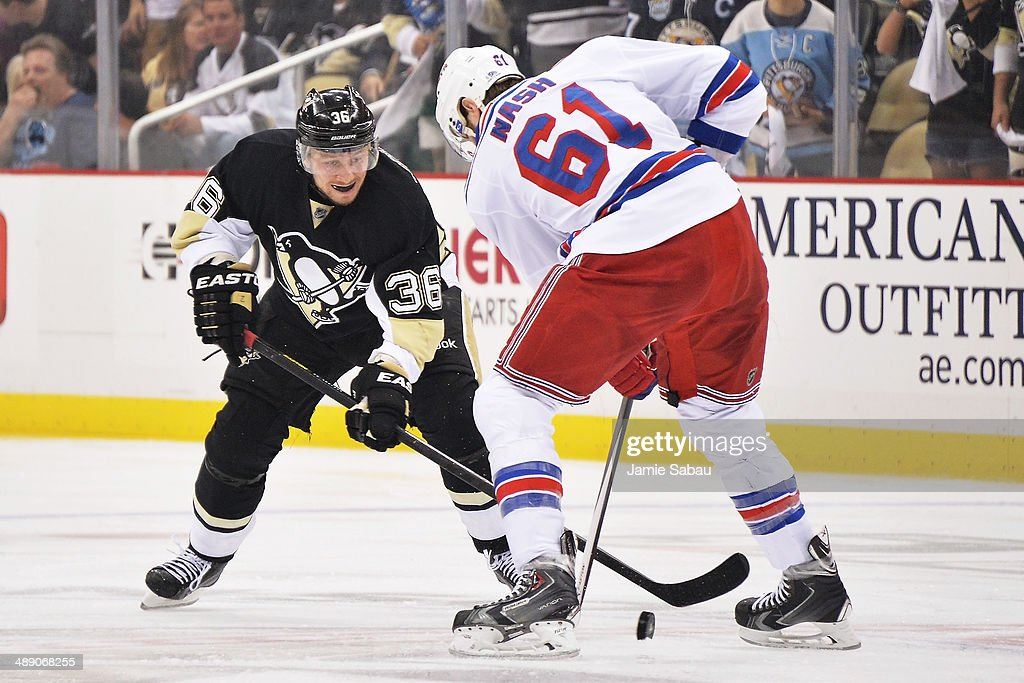 Jussi Jokinen #36 of the Pittsburgh Penguins defends against Rick Nash #61 of the New York Rangers in the second period in Game Five of the Second Round of the 2014 NHL Stanley Cup Playoffs on May 9, 2014 at CONSOL Energy Center in Pittsburgh, Pennsylvania. New York defeated Pittsburgh 5-1.