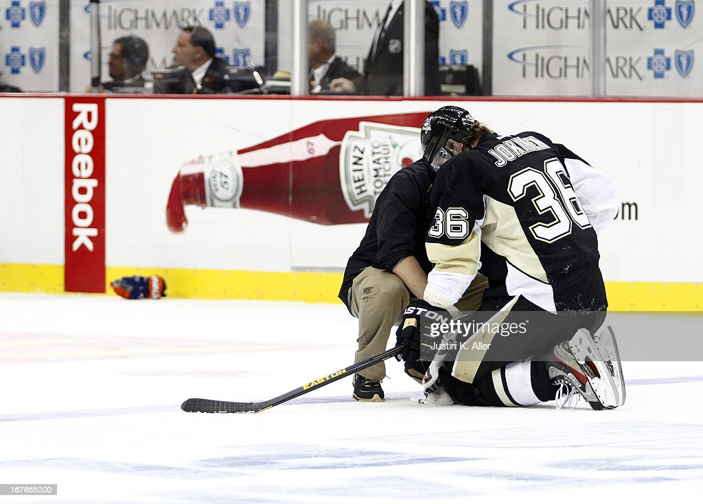 <a gi-track='captionPersonalityLinkClicked' href=/galleries/search?phrase=Jussi+Jokinen&family=editorial&specificpeople=570599 ng-click='$event.stopPropagation()'>Jussi Jokinen</a> #36 of the Pittsburgh Penguins is tended to by medical staff against the New York Islanders in Game One of the Eastern Conference Quarterfinals during the 2013 NHL Stanley Cup Playoffs at Consol Energy Center on May 1, 2013 in Pittsburgh, Pennsylvania. The Penguins won 5-0.