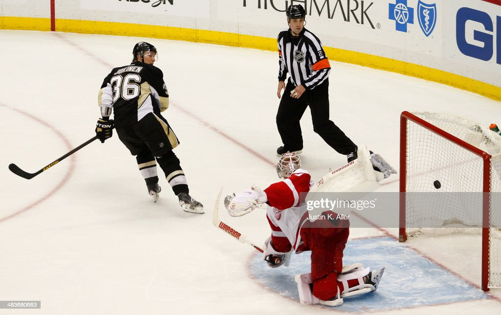Jussi Jokinen #36 of the Pittsburgh Penguins scores against Jonas Gustavsson #50 of the Detroit Red Wings during the shootout at Consol Energy Center on April 9, 2014 in Pittsburgh, Pennsylvania. The Penguins defeated the Red Wings 4-3 in a shootout.