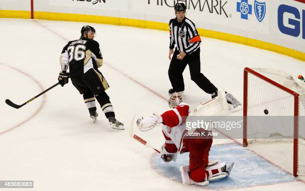 Jussi Jokinen of the Pittsburgh Penguins scores against Jonas Gustavsson of the Detroit Red Wings during the shootout at Consol Energy Center on...