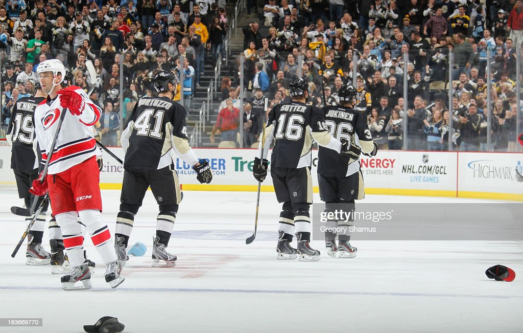 <a gi-track='captionPersonalityLinkClicked' href=/galleries/search?phrase=Jussi+Jokinen&family=editorial&specificpeople=570599 ng-click='$event.stopPropagation()'>Jussi Jokinen</a> #36 of the Pittsburgh Penguins skates to the bench after his hat trick goal during the third period against the Carolina Hurricanes on October 8, 2013 at Consol Energy Center in Pittsburgh, Pennsylvania.