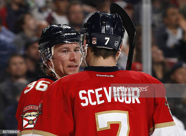 Jussi Jokinen talks to Colton Sceviour of the Florida Panthers during a break in action against the Toronto Maple Leafs at the BBT Center on December...