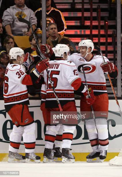 Jussi Jokinen Tuomo Ruutu and Joni Pitkanen of the Carolina Hurricanes celebrate a goal in the first period against the Boston Bruins on November 26...