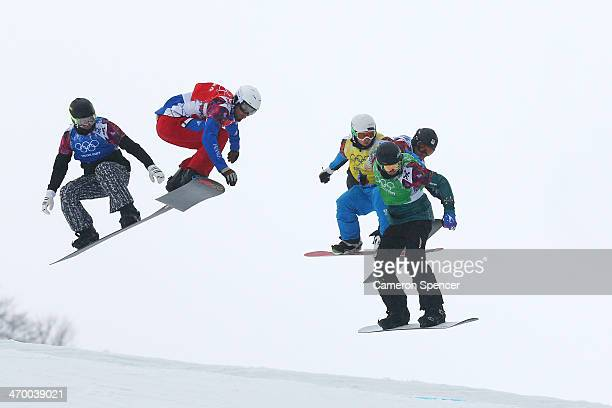 Jussi Taka of Finland Pierre Vaultier of France Hanno Douschan of Austria and Jarryd Hughes of Australia compete in the Men's Snowboard Cross 1/8...