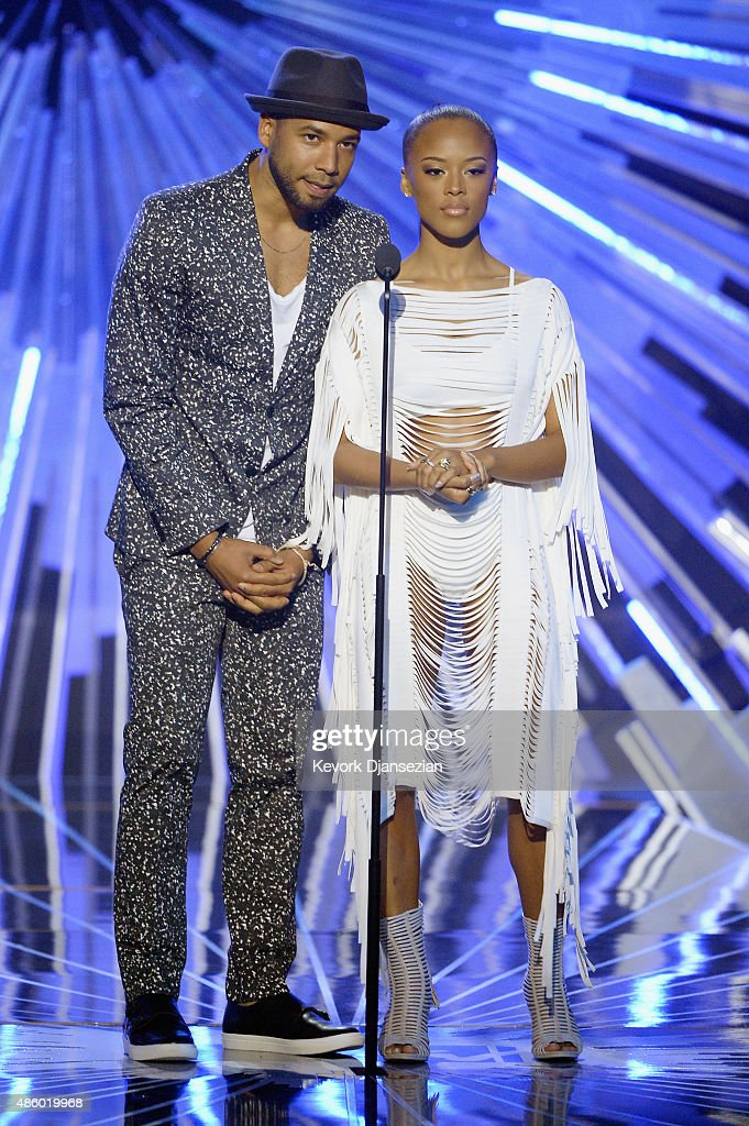 Jussie Smollett (L) and Serayah speak onstage during the 2015 MTV Video Music Awards at Microsoft Theater on August 30, 2015 in Los Angeles, California.