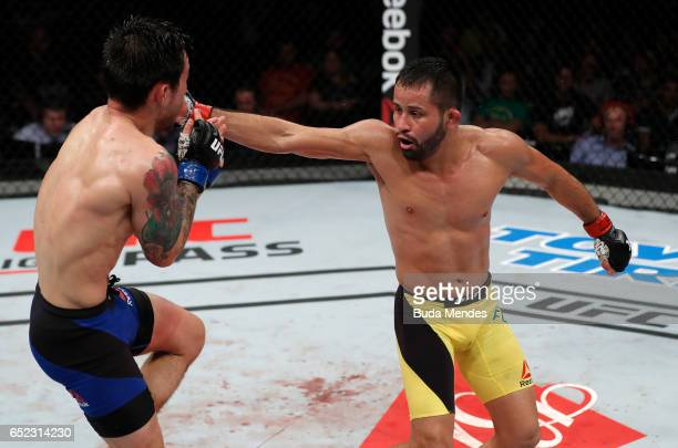 Jussier Formiga of Brazil lands a spinning back fist against Ray Borg in their flyweight bout during the UFC Fight Night event at CFO Centro de...