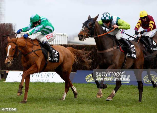 Just A Par ridden by Harry Cobden gets the better of Shotavodka ridden by Tom Scudamore to win The Betway Supporting Greatwood Veterans' Handicap...