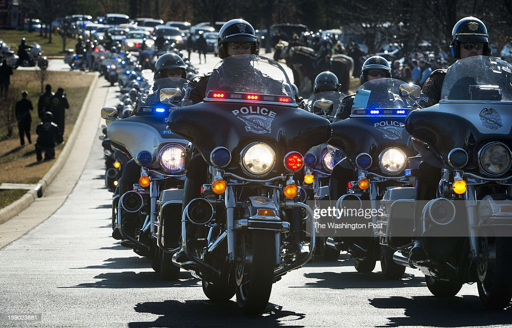 Just a small portion of the Police and civilian motorcycles attending the funeral motorcade for Prince William County Police Officer Chris Yung on Friday, January 4, 2013.