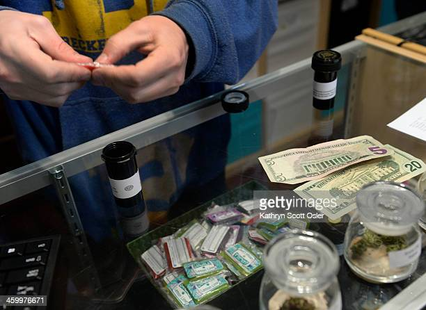 Just after the 8 am opening inside the Cannabis Club on Main Street downtown customers are busy buying their marijuana in various forms including...