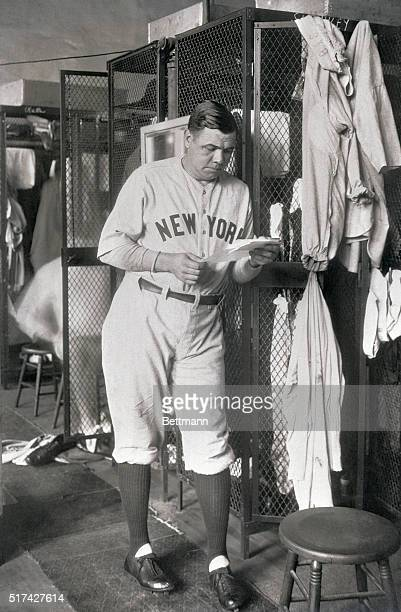 Just as Babe Ruth is all ready for the ball game in comes the mailman with a bunch of letters from his thousands of youthful fans