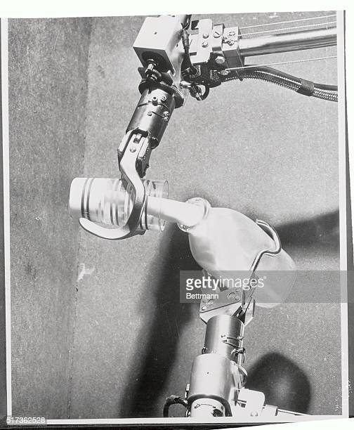 Just as milk is poured out of a bottle here mechanical hands can mix chemicals in experiments that have to be performed in radioactive areas