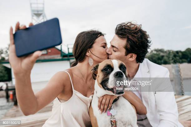 Just engaged couple taking selfie with dog