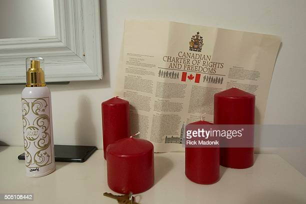 Just inside the doorway to their new home a copy of the Canadian Charter of Rights and Freedom sits atop a piece of furniture Hamzeh Morad his wife...