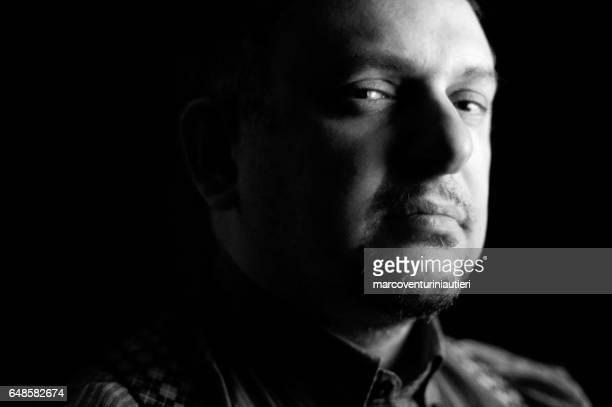 Just like a mafia boss - chiaroscuro portrait with evil look