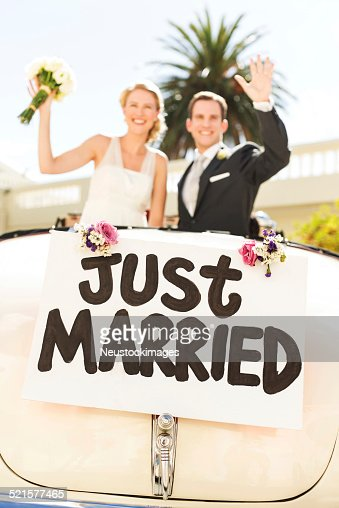 Just Married Couple Waving In Car