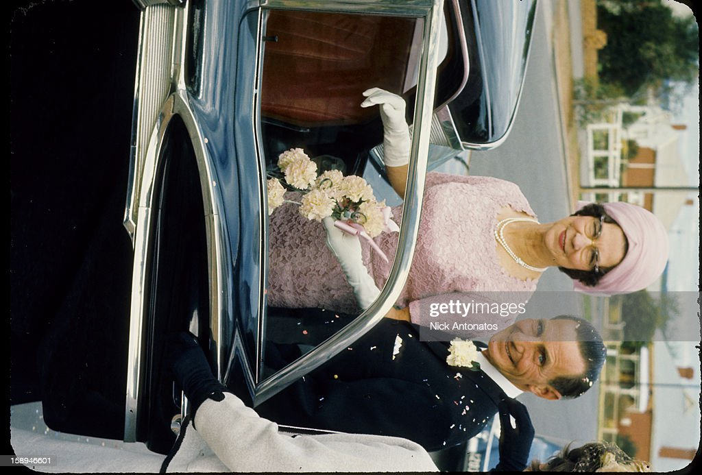 CONTENT] Just married older couple getting into their 1957 Ford wedding car. Scanned from Kodachrome slide of that year.
