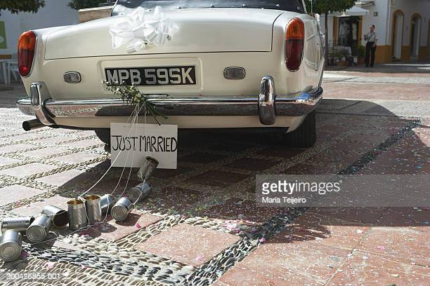 'Just married' sign and tin cans on rear of car