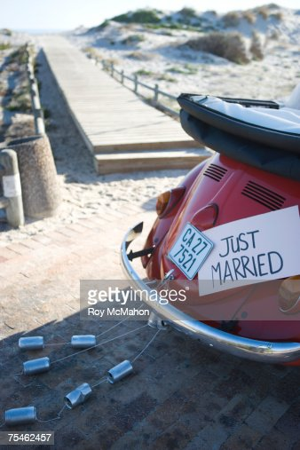 Just married sign on car on beach