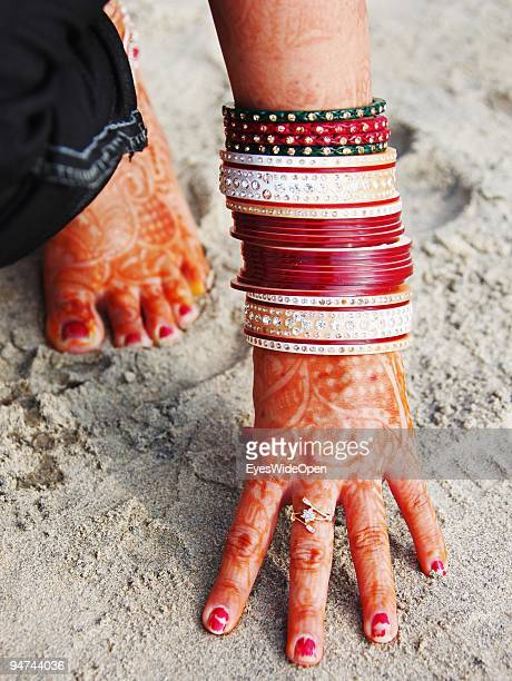 Just married woman is showing her traditional henna paintings on her hand and foot on December 13 2009 in Kovalam Beach near Trivandrum India...
