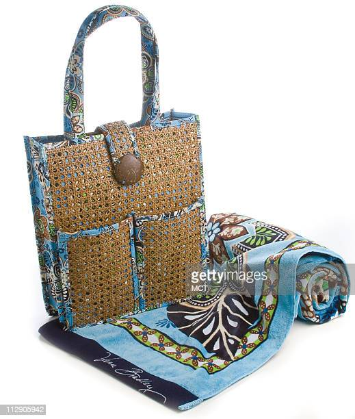 Just when you couldn't imagine still another chunky fun Vera Bradley print Bali Blue and Hope Garden appear in the '09 collection The structured...