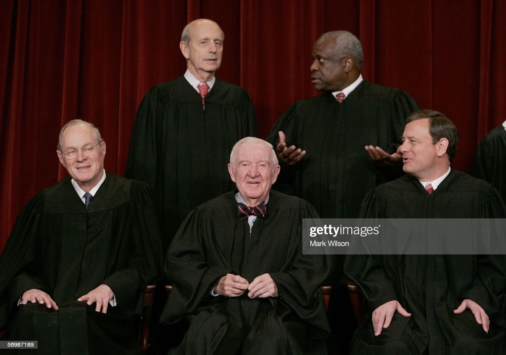 , Justice Anthony M. Kennedy , Justice John Paul Stevens, Chief Justice John G. Roberts, Justice <a gi-track='captionPersonalityLinkClicked' href=/galleries/search?phrase=Antonin+Scalia&family=editorial&specificpeople=215620 ng-click='$event.stopPropagation()'>Antonin Scalia</a>, , Justice David H. Souter. (Second Row L to R) Justice Stephen G. Breyer , Justice Clarence Thomas chat during a photo session with photographers at the U.S. Supreme Court March 3, 2006 in Washington DC.