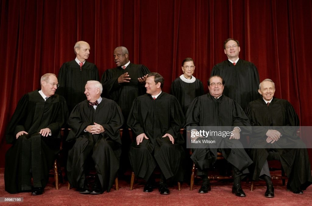 , Justice Anthony M. Kennedy , Justice John Paul Stevens, Chief Justice John G. Roberts, Justice <a gi-track='captionPersonalityLinkClicked' href=/galleries/search?phrase=Antonin+Scalia&family=editorial&specificpeople=215620 ng-click='$event.stopPropagation()'>Antonin Scalia</a>, , Justice David H. Souter. (Second Row L to R) Justice Stephen G. Breyer , Justice Clarence Thomas, Justice Ruth Bader Ginsburg and Justice Samuel Alito pose for photographers at the U.S. Supreme Court March 3, 2006 in Washington DC.