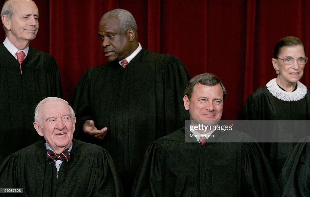 , Justice Anthony M. Kennedy , Justice John Paul Stevens, Chief Justice John G. Roberts, (Second Row L-R) Justice Stephen G. Breyer , Justice Clarence Thomas and Justice <a gi-track='captionPersonalityLinkClicked' href=/galleries/search?phrase=Ruth+Bader+Ginsburg&family=editorial&specificpeople=199152 ng-click='$event.stopPropagation()'>Ruth Bader Ginsburg</a> chat during a photo session with photographers at the U.S. Supreme Court March 3, 2006 in Washington DC.