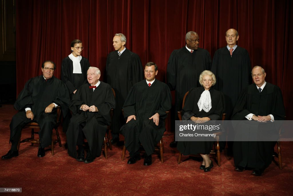 Justice Antonin Scalia, Justice John Paul Stevens, Chief Justice John G. Roberts, Justice Sandra Day O'Connor, Justice Anthony M. Kennedy, (Second Row L-R) Justice Ruth Bader Ginsburg, Justice David H. Souter, Justice Clarence Thomas and Justice Stephen G. Breyer pose for photographers at the U.S. Supreme Court October 31, 2005 in Washington DC. Earlier in the day U.S. President George W. Bush nominated judge Samuel Alito to replace Sandra Day O'Connor who is retiring once her replacement is confirmed by the Senate.