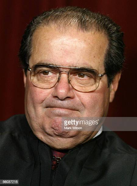 Justice Antonin Scalia poses for photographers at the US Supreme Court October 31 2005 in Washington DC Earlier in the day US President George W Bush...