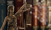 Justice law legal concept. statue of justice or lady justice with law books background.