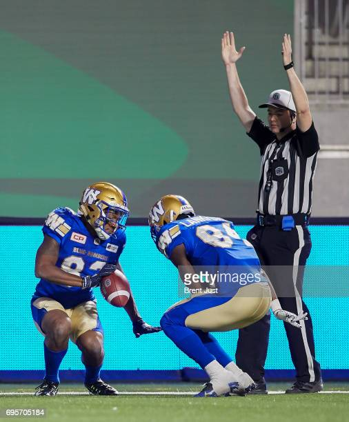 Justice Liggins and Ryan Lankford of the Winnipeg Blue Bombers celebrate after a touchdown in the preseason game between the Winnipeg Blue Bombers...
