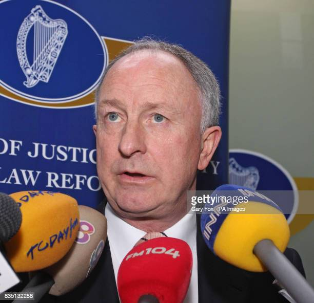 Justice Minister Dermot Ahern speaks to the media during a press conference at the Department of Justice in St Stephens Green Dublin A family with a...