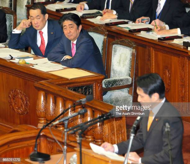 Justice Minister Katsutoshi Kaneda and Prime Minister Shinzo Abe listen to the question by Yasufumi Fujino of Japan Communist Party about an...