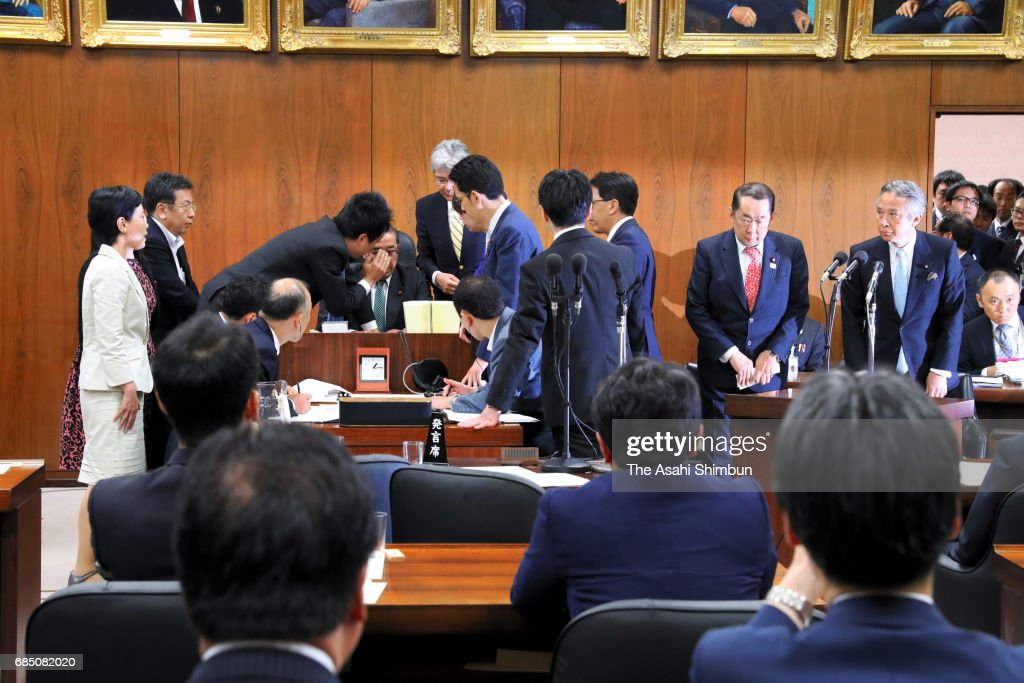 Justice Minister Katsutoshi Kaneda, (2nd R) appears calm while opposition lawmakers surround the chairman of the Lower House Judicial Affairs Committee session as the ruling coalition rammed anti-conspiracy legislation on May 19, 2017 in Tokyo, Japan. Opposition parties are trying to block passage, saying the legislation could lead to human rights violations concerning freedom of thought and conscience. The legislation covers 277 crimes and would make illegal even the planning or discussing of those possible crimes among members of an organized group. The government has said passage of the legislation was a precondition for Japan joining the U.N. Convention against Transnational Organized Crime (TOC). It has also said the proposed law would make Japan safer during the 2020 Tokyo Summer Olympics.
