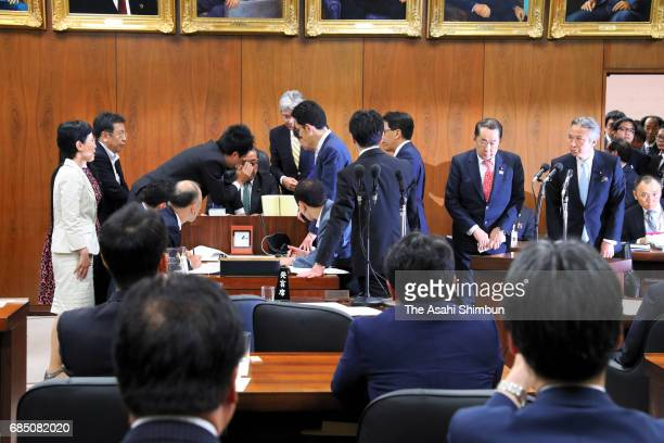 Justice Minister Katsutoshi Kaneda appears calm while opposition lawmakers surround the chairman of the Lower House Judicial Affairs Committee...