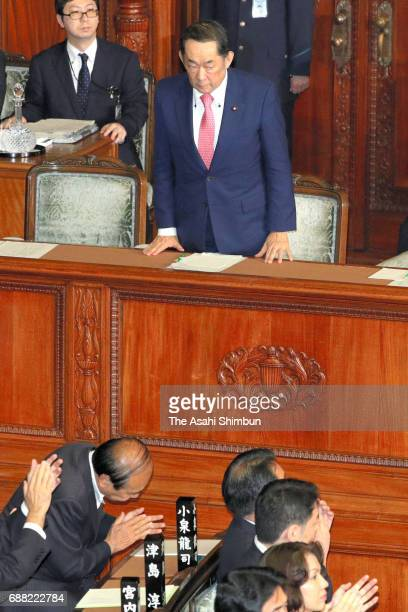 Justice Minister Katsutoshi Kaneda bows after the anticonspiracy legislation passed the Lower House at the Diet on May 23 2017 in Tokyo Japan The...