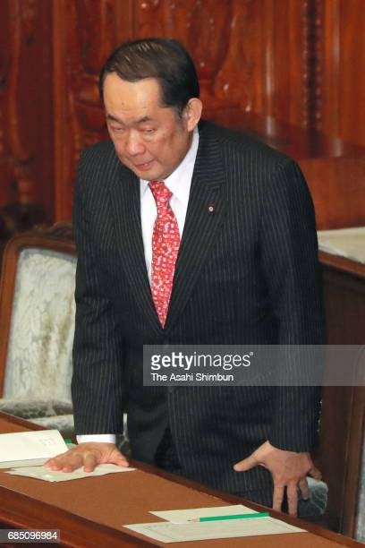 Justice Minister Katsutoshi Kaneda bows after the ruling coalition of the Liberal Democratic Party and Komeito defeated a noconfidence motion against...